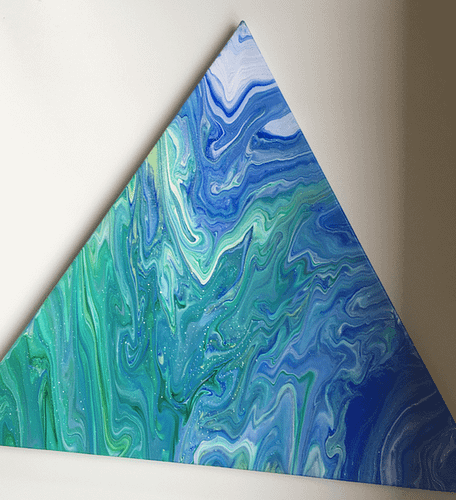 A triangular painting with blue and green swirls of colour