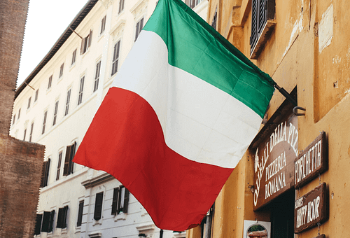 An Italian flag waving from a building