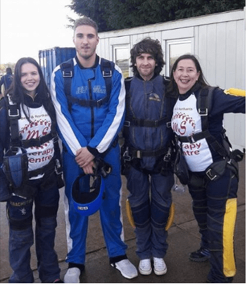 Group of 4 people in skydiving suits