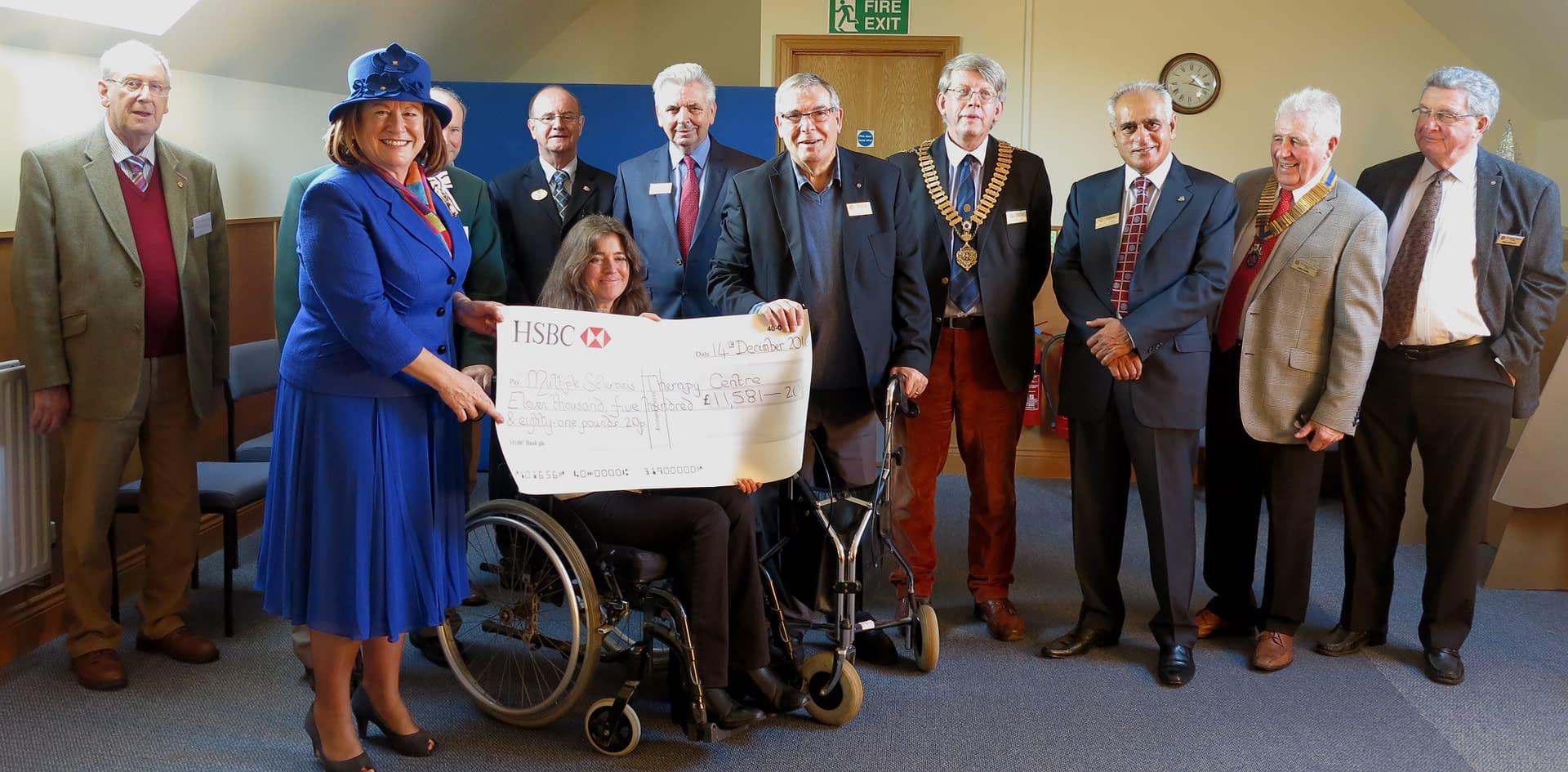A group of people with a large cheque