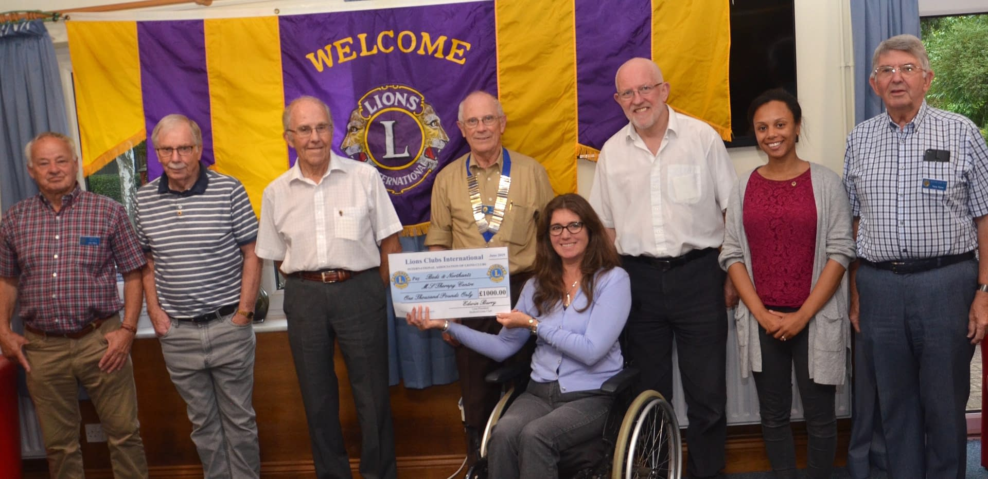 A group of people with the Lions club banner